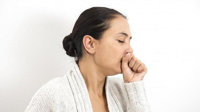 Ilustrasi seorang perempuan sedang batuk.