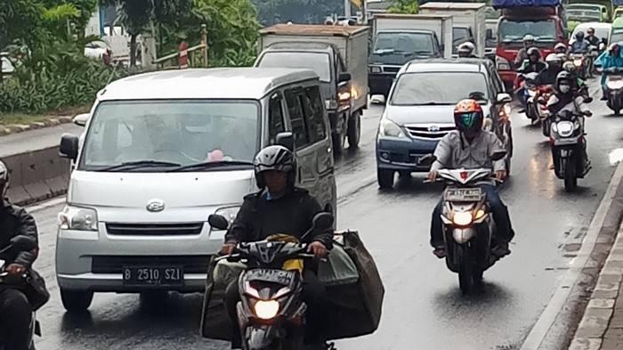 BERITA FOTO: Beginilah Akivitas Warga Jakarta dan Tangerang di Jalanan saat Wabah Virus Corona