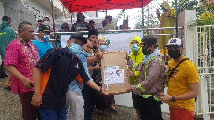 DPP BKPRMI Salurkan Bantuan Kabaharkam Polri Untuk Korban Banjir di Banjarmasin
