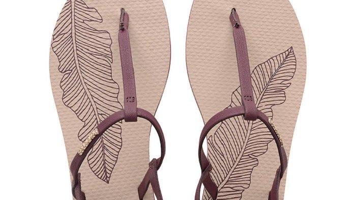 Ilustrasi sandal jepit Havaianas yang tetap gaya dan nyaman saat dipakai traveling