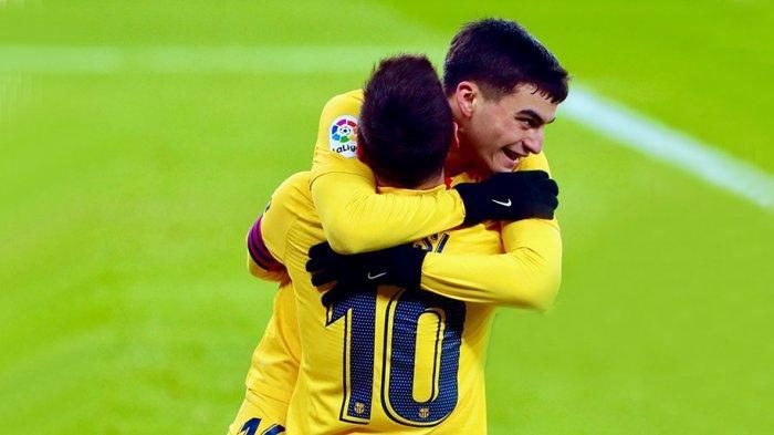 Pedri merayakan gol bersama Lionel Messi saat menyamakan kedudukan 1-1 dengan Athletic Bilbao