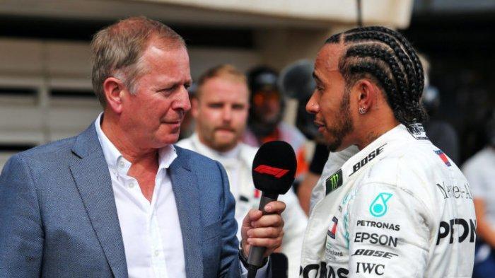 Martin Brundle (kiri) mantan pebalap F1 sekarang komentator tv sedang mewawancarai Lewis Hamilton