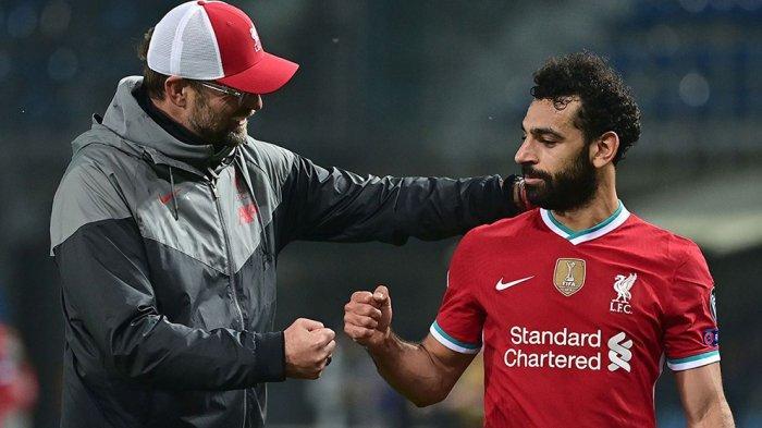 Pelatih Liverpool Jurgen Klopp dan Mohamed Salah.