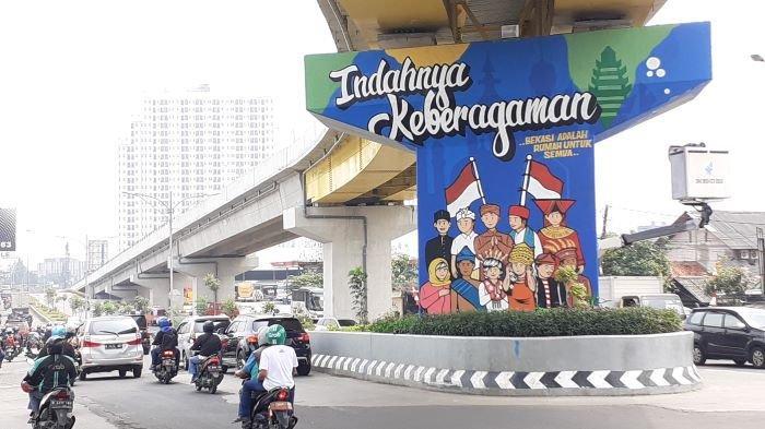 Komunitas Spasih Gambar Mural Bertema Keberagaman Indonesia di Jalan Layang Rawapanjang Bekasi