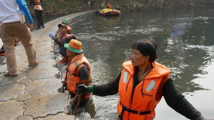 Peringati Hari Lingkungan Hidup, Palyja Bersihkan Kali Ciliwung
