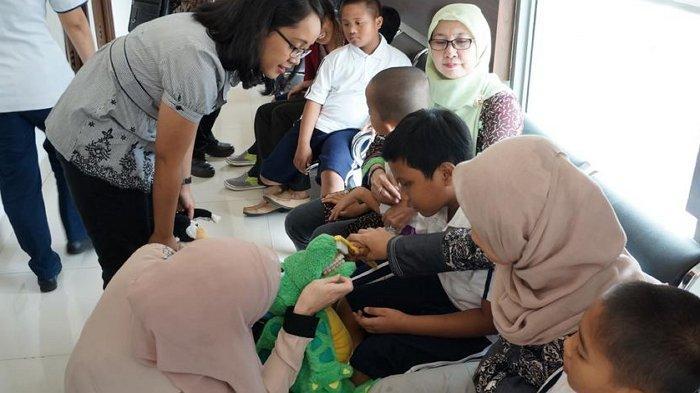 Kesehatan Gigi Anak Down Syndrome Harus Diperhatikan Sedari Dini, Jangan Sampai Terlambat