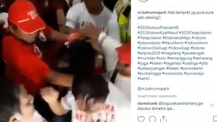 Pendukung Jokowi Tertangkap Kamera Suntrungi Kepala Penyusup yang Diduga Acungkan Jari 02