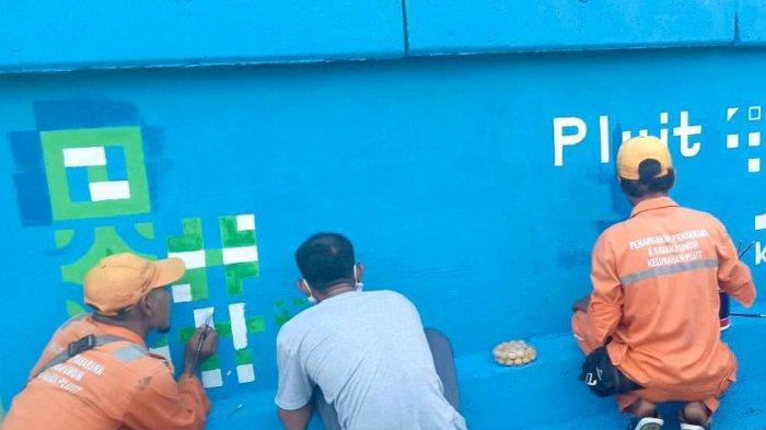 Ramaikan HUT DKI Ke-492, PPSU Pluit Sulap Tembok di Penjaringan Jadi Kanvas Penuh Lukisan