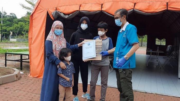Satu keluarga dinyatakan sembuh dari infeksi covid-19 usai menjalani isolasi dan perawatan medis di RLC Kota Tangsel