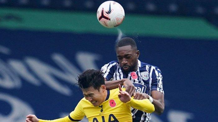 Son Heung-min berduel di udara dengan pemain West Bromich Albion