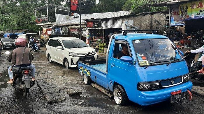 Diprotes Warga Hingga Ditebari Lele 25Kg, Jalan Curug Nangka yang Rusak Parah Akhirnya Diperbaiki