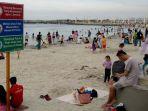20161225libur-panjang-pengunjung-di-pantai-ancol-membludak1_20161225_143150.jpg