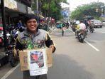 20170310pengemudi-ojek-online-galang-dana-di-pinggir-jalan-untuk-jamil_20170310_154406.jpg