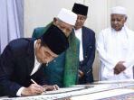 20170621-presiden-joko-widodo-memulai-penulisan-al-quran-akbar_20170621_112251.jpg