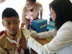 20180110cegah-penyebaran-difteri-844-siswa-smpn-122-jakarta-utara-jalani-vaksinasi_20180110_164054.jpg