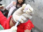20180128-gerebekan-virus-difteri-di-kelurahan-duri-selatan5_20180128_224430.jpg