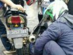 20180212dua-sepeda-motor-adu-banteng-di-jalan-sawangan-depok-satu-pengendara-motor-luka-luka_20180212_145029.jpg