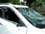 20180301pengemudi-xtrail-laporkan-kasus-pengrusakan-mobilnya-oleh-oknum-ojol_20180301_133532.jpg