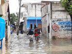 banjir-di-rawa-buaya1212.jpg