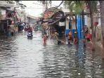 banjir-di-rawabuaya.jpg