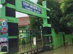 banjir-smpn-08-tambun-selatan-kabupaten-bekasi-diliburkan.jpg