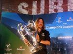 carles-puyol-dan-piala-liga-champions.jpg