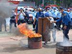 demonstrasi-jinakan-api.jpg