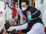 direktur-utama-bpjs-kesehatan-fachmi-idris-melakukan-peninjauan-kegiatan-vaksinasi-covid-19.jpg