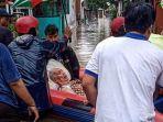 evakuasi-warga-dari-banjir.jpg