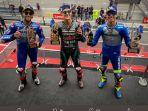 fabio-quartararo-di-podium-juara-ditemani-oleh-pebalap-suzui-ecstar-joan-mir.jpg