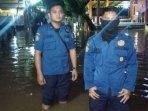 foto-petugas-penanggulangan-bencana-banjir-depok210501.jpg