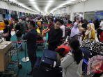 ilustrasi-lonjakan-penumpang-di-bandara-soetta_20170630_185521.jpg