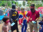pembagian-masker-di-jakarta-pusat-melibatkan-tokoh-superhero-dan-ondel-ondel.jpg