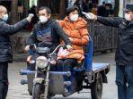 pemeriksaan-suhu-warga-china-dari-virus-corona.jpg