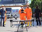 pemkot-bekasi-kerahkan-drone-semprot-disinfektan-di-sejumah-ruas-jalan.jpg