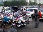 penyemprotan-mobil-polisi.jpg