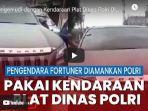 petugas-kepolisiam-menghentikan-sebuah-mobil-toyota-fortuner-yang-memakai-plat-nomor-dinas-polri.jpg