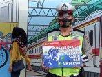 polisi-kampaye-protokol-kesehatan-penggunaan-masker-di-stasiun-tanah-abang240820202.jpg