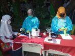 proses-skrining-salah-satu-peserta-vaksinasi-kategori-smp-negeri-21-kota-bekasi.jpg