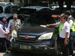 puluhan-mobil-penunggak-pajak-di-parkiran-kantor-wali-kota-jakarta-utara-terjaring-razia181.jpg
