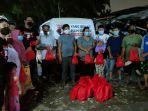 relawan-sahabat-ganjar-beri-bantuan-ke-warga-terdampak-pandemi-covid-19.jpg