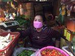 rini-pedagang-sayur-di-pasar-citayam.jpg