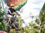 sandiaga-uno-menjajal-sepeda-gantung-di-desa-wisata-tungkal-selatan.jpg