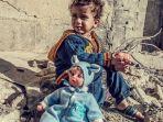 seorang-bocah-suriah-korban-konflik-berkepanjangan-di-negara-itu.jpg
