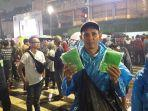 ucup-40-pedagang-jas-hujan-di-bundaran-hotel-indonesia-hi.jpg