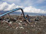 warga-palu-kumpulkan-besi-sisa-gempa-dan-tsunami_20181013_123849.jpg