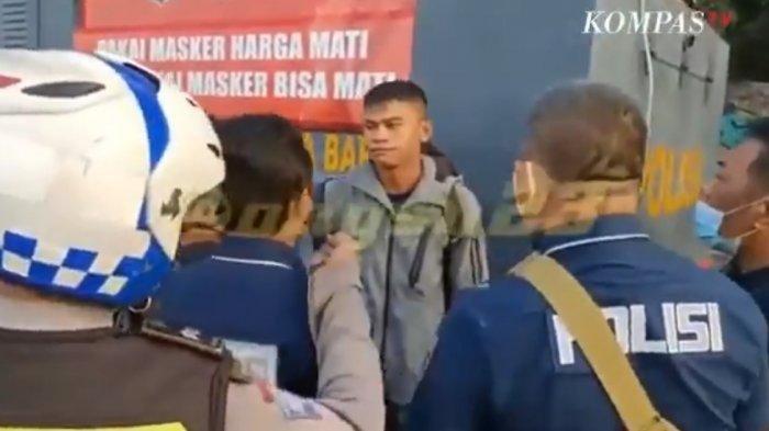 Anggota Paspampres Praka Izroi Gajah yang dikerubuti petugas kepolisian berpakaian preman.
