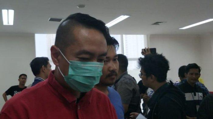 Andi Wibowo, pengemudi BMW yang keluarkan senjata saat macet di Gambir, Jakarta Pusat, ditangkap polisi, Sabtu (15/6/2019).