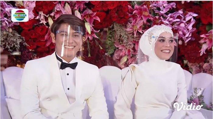 Pasangan Rizky Billar dan Lesti Kejora saat acara Tasyakuran Pernikahan, Minggu (29/8/2021).