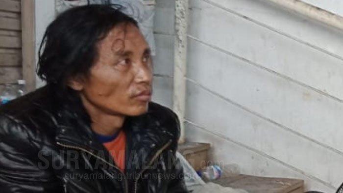 Pelaku Pembunuhan dan Mutilasi di Pasar Besar Kota Malang saat ditangkap polisi, Rabu (15/5/2019)